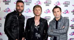 Muse succeed over Olly Murs in battle to top of the charts (Ian West/PA)