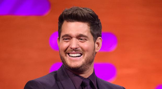 Michael Buble triumphed over Mumford and Sons to claim his fourth number one album (Matt Crossick/PA)