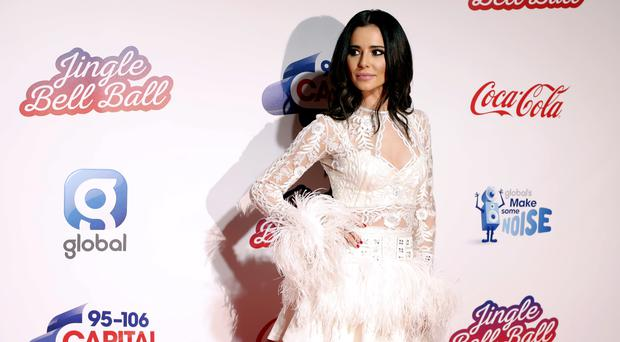 Cheryl wore a feathered dress (David Parry/PA)