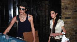 Singer Amy Winehouse and her husband Blake Fielder-Civil (Joel Ryan/PA)