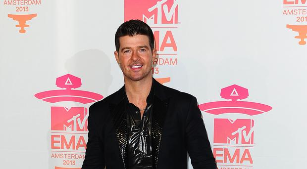 Robin Thicke is engaged to April Love Geary (Ian West/PA)