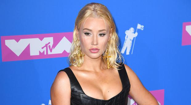 Iggy Azalea has defended finishing a concert after a backing dancer suffered a seizure mid-song (PA/PA Wire)