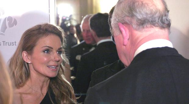 The Prince of Wales speaks to Geri Horner during a reception at the Savoy in London (Peter Cary/PA)