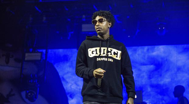 Grammy-nominated rapper 21 Savage's legal team has denied reports he was in possession of a gun when he was arrested (Amy Harris/Invision/AP, File)