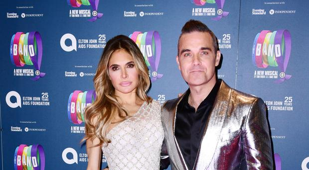 Ayda Field and Robbie Williams have three children (Ian West/PA)