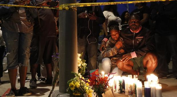 Tributes outside the clothes shop of Nipsey Hussle (Damian Dovarganes/AP)