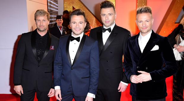 (left to right) Kian Egan, Shane Filan, Mark Feehily and Nicky Byrne of Westlife are set to embark on a new tour following their reunion (Ian West/PA)