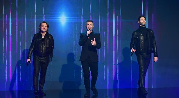 Take That's current line-up is Gary Barlow, Mark Owen and Howard Donald (Ian West/PA)