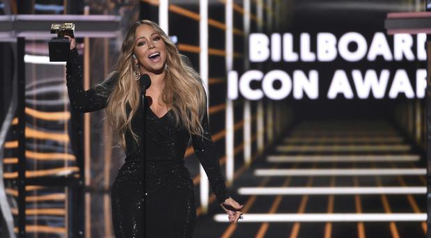 An emotional Mariah Carey said she 'always felt like an outsider' as her glittering career was recognised at the Billboard Music Awards (Chris Pizzello/Invision/AP)