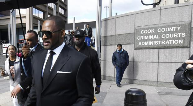 R Kelly leaves the Leighton Criminal Court building after a hearing in Chicago (Matt Marton/AP)