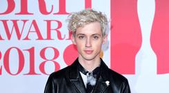 Charli XCX and Troye Sivan have unveiled the line-up for their new music festival (Ian West/PA)