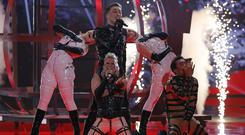 Hatari of Iceland perform during the Eurovision Song Contest grand final (Sebastian Scheiner/AP)