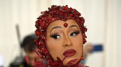 Cardi B is 'very disappointed' after having to postpone a concert while she recovers from plastic surgery (Jennifer Graylock/PA)