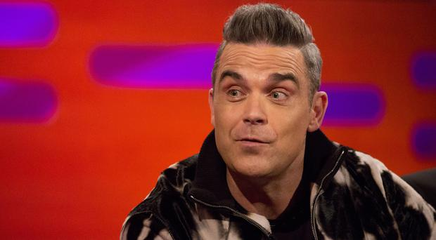 Robbie Williams becomes co-owner of LMA performing arts and media academy (Isabel Infantes/PA)