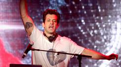 Mark Ronson: Fans won't stop throwing Curly Wurly bars at me on stage (Isabel Infantes/PA)
