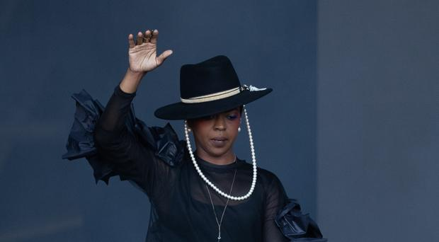 Lauryn Hill grappled with sound issues throughout her Glastonbury set after arriving on stage late (Aaron Chown/PA)