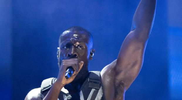 Stormzy has made history by becoming the first black British solo artist to headline Glastonbury Festival in its 49-year history (Aaron Chown/PA)
