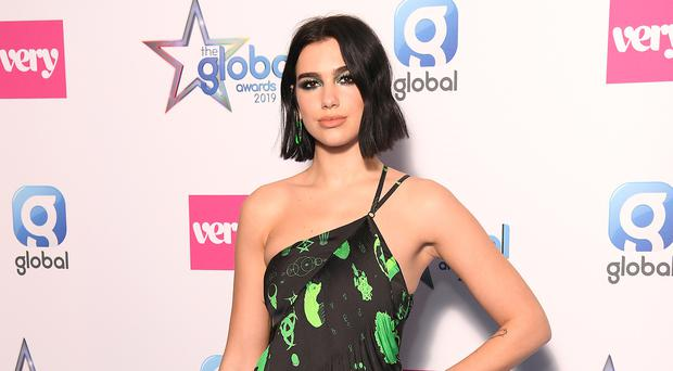 Dua Lipa says she 'survived' Glastonbury as other stars recover with food (Scott Garfitt/PA)