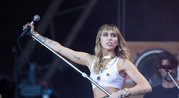 Miley Cyrus has reportedly split with husband Liam Hemsworth (Aaron Chown/PA)