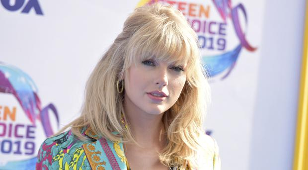 Taylor Swift was among the stars walking the blue carpet before the 2019 Teen Choice Awards (Richard Shotwell/Invision/AP)