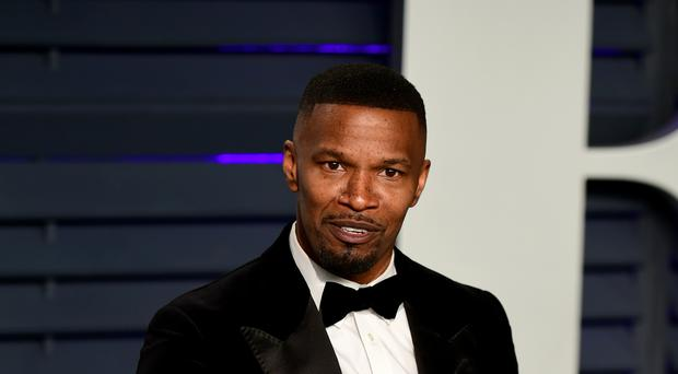 Jamie Foxx has denied being in a relationship with a 21-year-old singer, days after it was reported he had split with Katie Holmes (Ian West/PA)