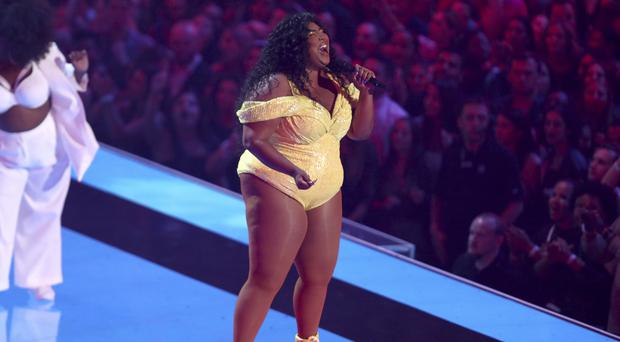 Lizzo ensured her Video Music Awards performance would be a memorable one by appearing in front of a giant pair of inflatable buttocks (Matt Sayles/Invision/AP)