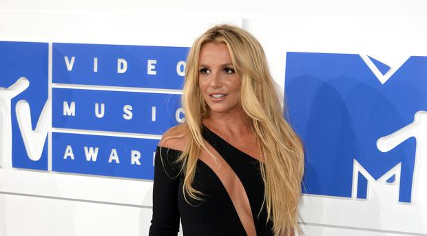 Britney Spears has ditched her blonde hair and gone brunette (PA Wire)