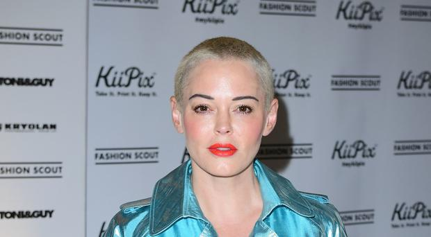 Like Sam Smith, Rose McGowan has said she identifies as non-binary (Ian West/PA)