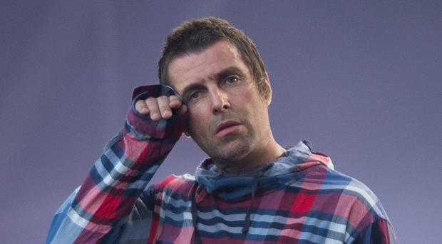 Liam Gallagher reveals whether Noel will be invited to his wedding (Aaron Chown/PA)