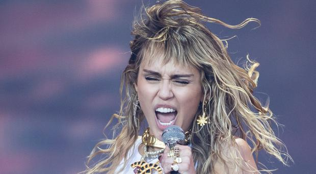 Miley Cyrus said she is 'inspired' as she returned to the recording studio following her split with Kaitlynn Carter (Aaron Chown/PA)
