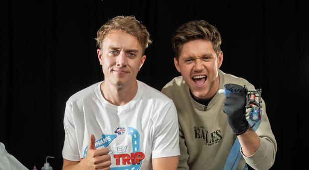 Niall Horan makes major error as he tattoos Roman Kemp's leg for charity (Global/Capital Breakfast)