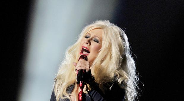 Christina Aguilera had her first number aged 18 (Tim Ireland/PA)