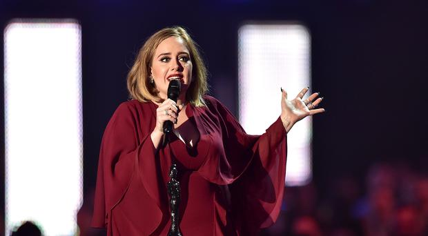 Adele has wished rapper Drake happy birthday after being pictured attending his star-studded party in Los Angeles (Dominic Lipinski/PA)