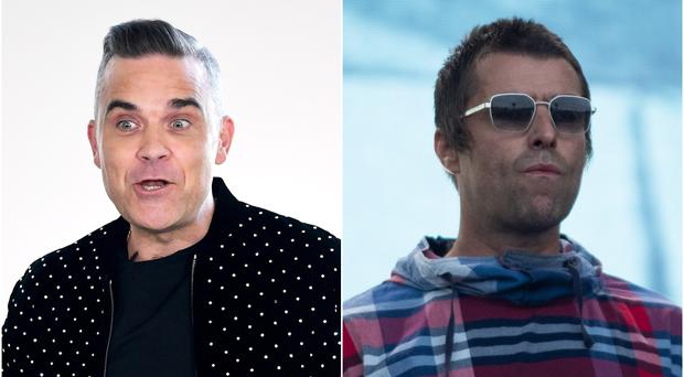 Robbie Williams and Liam Gallagher (PA)