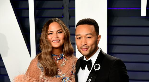 Chrissy Teigen and John Legend attending the Vanity Fair Oscar Party (PA)