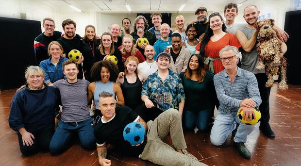 Robbie Williams pays a surprise visit to see the cast rehearse The Boy In The Dress (Leo Baron)