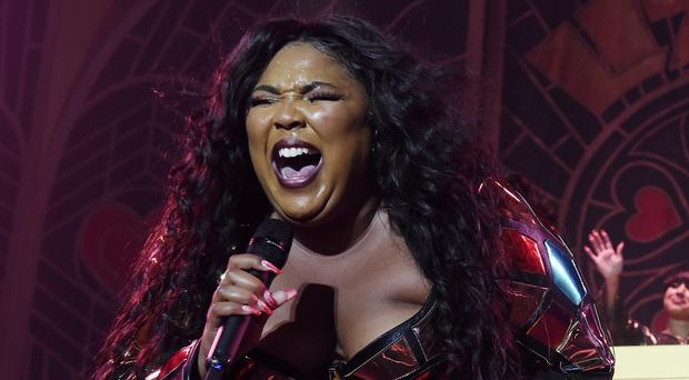 Pop star Lizzo made her case for Halloween costume of the year by dressing up as a DNA test (Chris Pizzello/Invision/AP)