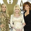 Carrie Underwood, Dolly Parton, and Reba McEntire at the 53rd annual CMA Awards (Evan Agostini/Invision/AP)