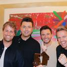 Westlife with their number one album award for Spectrum (OfficialCharts.com/PA)
