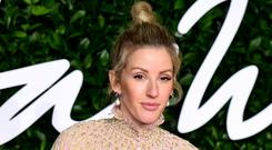 Ellie Goulding has revealed she turned to alcohol in a bid to become 'more interesting' as she adjusted to life in the spotlight (Ian West/PA)
