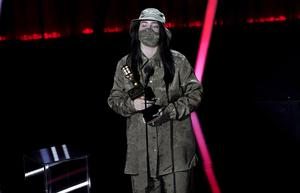 Billie Eilish wore a mask to accept one of her gongs at the Billboard Music Awards (AP Photo/Chris Pizzello)