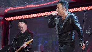 The Edge, left, and Bruce Springsteen perform during the World Aids Day concert in Times Square (Invision/AP)