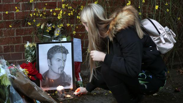 George Michael's family has asked for fan tributes at his homes to be removed (Andrew Matthews/PA)