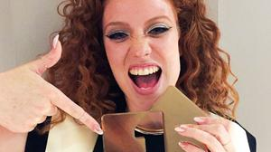 Jess Glynne with her gold Official Number 1 Album Award for I Cry When I Laugh (Official Charts Company/PA)
