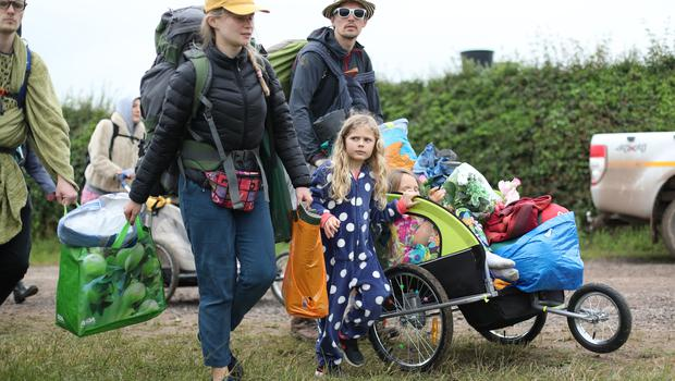 People arrive on the first day of the Glastonbury Festival at Worthy Farm in Somerset (Yui Mok/PA)
