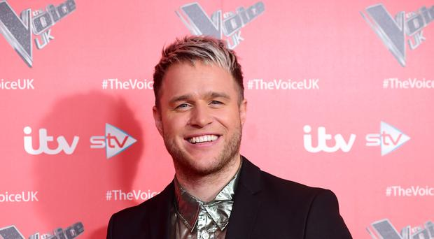 Olly Murs found love with Amelia Tank while he was on a break from showbiz (Ian West/PA)