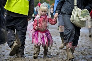 Lyra Warrilow, pictured in 2011, enjoying her third Glastonbury Festival aged four (PA)