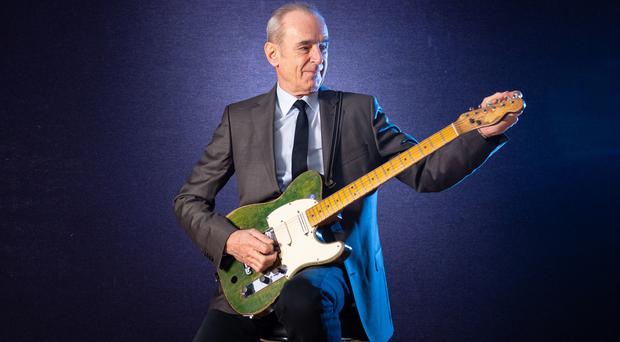 Francis Rossi of Status Quo with his green Fender Telecaster guitar (Dominic Lipinski/PA)