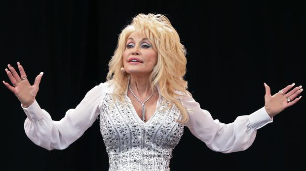 Dolly Parton has been inoculated by the coronavirus vaccine she helped to fund (Yui Mok/PA)