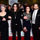 Kelly Osbourne, Ozzy Osbourne, Sharon Osbourne and Jack Osbourne (Ian West/PA)